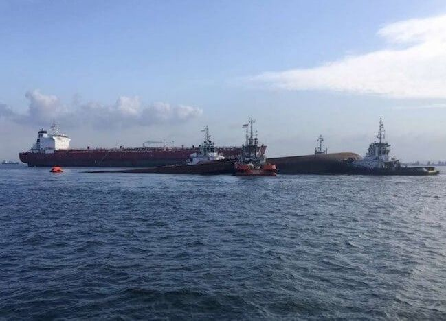 Five crew members missing after collision between tanker and dredger in Singapore